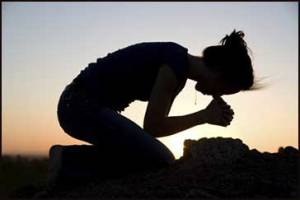 woman_praying_silhouette